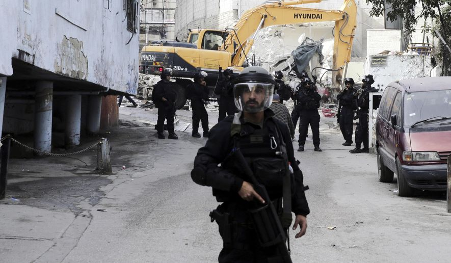 In this Wednesday, Nov. 21, 2018. photo, Israeli authorities destroy shops in the refugee camp of Shuafat in Jerusalem. President Donald Trump's recognition of Jerusalem has set off an increasingly visible battle in the city's eastern sector _ with an emboldened Israel seeking to cement its control over the contested area and Palestinians pushing back to maintain their limited foothold. (AP Photo/Mahmoud Illean)