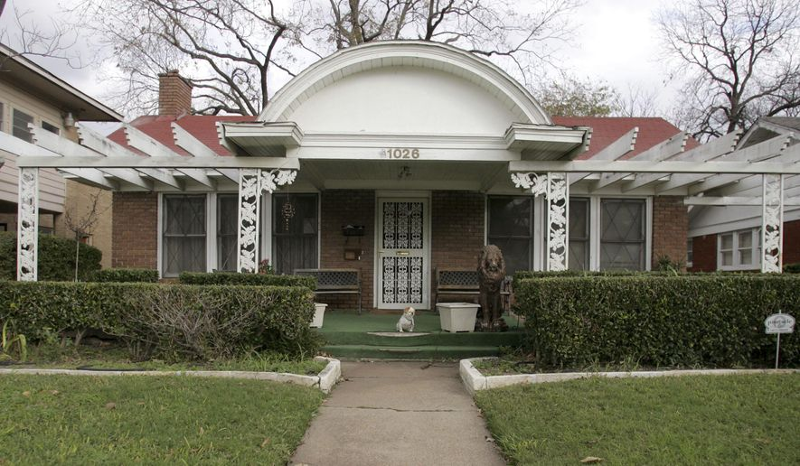 This Nov. 20, 2009 photo shows the exterior of home that has served as a rooming house where Lee Harvey Oswald lived before President John F. Kennedy was assassinated on Nov. 22, 1963. (Jen Friedberg/The Dallas Morning News via AP)