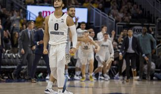 Marquette  guard Markus Howard reacts after a basket against Kansas State during the second half of an NCAA basketball game Saturday, Dec. 1, 2018, in Milwaukee. (AP Photo/Darren Hauck)