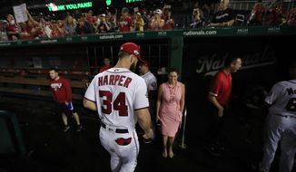 FILE - In this Sept. 26, 2018 file photo, Washington Nationals Bryce Harper (34) leaves the field as the Nationals ended their last home game of the season with a 9-3 rain delayed win against the Miami Marlins in Washington.  As much as the Nationals already have done to try to improve a team that flopped in 2018, one question will hover over their offseason until it's resolved: What is going to happen with Harper?  (AP Photo/Manuel Balce Ceneta, File)