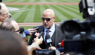 In this April 5, 2018 file photo, Washington Nationals general manager Mike Rizzo speaks during a media availability before the home opener baseball game against the New York Mets at Nationals Park in Washington. As much as the Nationals already have done to try to improve a team that flopped in 2018, one question will hover over their offseason until it's resolved: What is going to happen with Bryce Harper?  (AP Photo/Alex Brandon, File) **FILE**