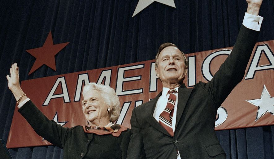 FILE - In this Nov. 8, 1988 file photo, President-elect George H.W. Bush and his wife Barbara wave to supporters in Houston, Texas after winning the presidential election. Bush has died at age 94. Family spokesman Jim McGrath says Bush died shortly after 10 p.m. Friday, Nov. 30, 2018, about eight months after the death of his wife, Barbara Bush. (AP Photo/Scott Applewhite, File)