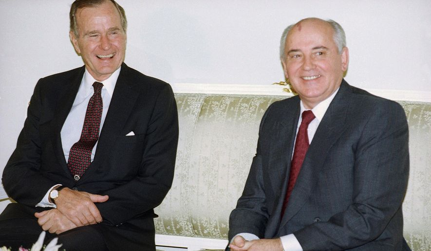 """In this photo taken on Tuesday, Oct. 29, 1991, U.S. President George H. Bush, left, and Soviet President Mikhail Gorbachev sit together at the Soviet Embassy after meeting in Madrid, Spain. Former Soviet premier Mikhail Gorbachev expressed his """"deep condolences"""" Saturday Dec. 1, 2018, to the family of former U.S President George Bush and all Americans following his death, age 94. (AP Photo/Liu Heung Shing, File)"""
