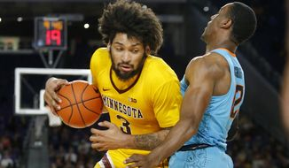 Minnesota's Jordan Murphy (3) drives around Oklahoma State's Cameron McGriff during the first half of an NCAA college basketball game Friday, Nov. 30, 2018, in Minneapolis. (AP Photo/Bruce Kluckhohn)