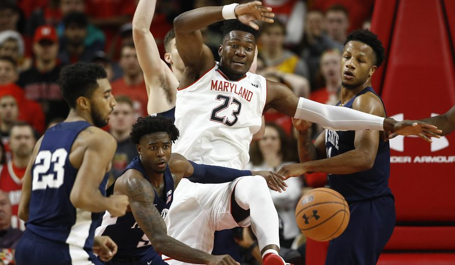 Maryland forward Bruno Fernando, center, of Angola, chases after a loose ball against Penn State guard Josh Reaves, from left, guard Jamari Wheeler and forward Lamar Stevens in the first half of an NCAA college basketball game, Saturday, Dec. 1, 2018, in College Park, Md. (AP Photo/Patrick Semansky)