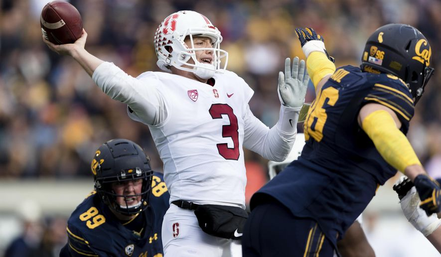 Stanford quarterback K.J. Costello (3) passes against California  in the second quarter of a football game in Berkeley, Calif., Saturday, Dec. 1, 2018. (AP Photo/John Hefti)