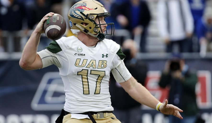 UAB quarterback Tyler Johnston III looks to pass against Middle Tennessee in the second half of the NCAA Conference USA championship college football game Saturday, Dec. 1, 2018, in Murfreesboro, Tenn. (AP Photo/Mark Humphrey)