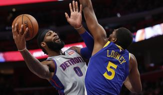 Detroit Pistons center Andre Drummond (0) shoots as Golden State Warriors forward Kevon Looney (5) defends during the first half of an NBA basketball game, Saturday, Dec. 1, 2018, in Detroit. (AP Photo/Carlos Osorio)