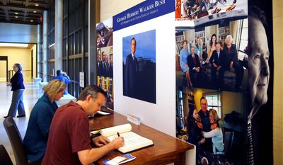 David Rodgers of San Diego and Cheryl Kilcheski of Irving, Texas, wrote condolences to the Bush family at the George W. Bush Presidential Library and Museum.