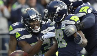 Seattle Seahawks wide receiver Jaron Brown, center, celebrates with wide receiver David Moore, left, and offensive tackle Duane Brown, right, after catching a pass for a touchdown during the second half of an NFL football game against the San Francisco 49ers, Sunday, Dec. 2, 2018, in Seattle. (AP Photo/Elaine Thompson)