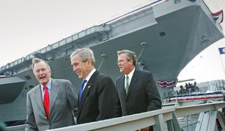 President Bush, center, with former President George H.W. Bush, left, and Florida Gov. Jeb  Bush, walk together after participating  in the christening ceremony of the aircraft carrier George H.W. Bush in Newport News, Va., Saturday, Oct. 7, 2006. (AP Photo/Lawrence Jackson)