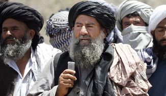 Senior leader of a breakaway faction of the Taliban Mullah Abdul Manan Niazi, center, delivers a speech to his fighters, in Shindand district of Herat province, Afghanistan, in this Friday, May 27, 2016 file photo. Niazi said Sunday, May 29, 2016 it was willing to hold peace talks with the Afghan government but would demand the imposition of Islamic law and the departure of all foreign forces. (AP Photos/Allauddin Khan) ** FILE **