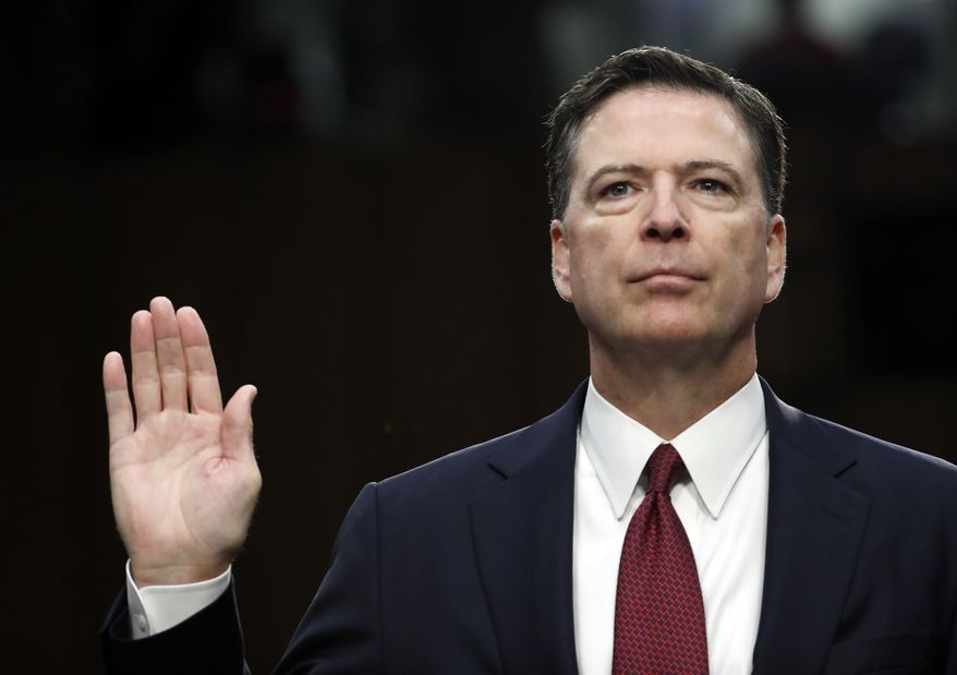 Former FBI Director James Comey is sworn in during a Senate Intelligence Committee hearing on Capitol Hill, Thursday, June 8, 2017, in Washington. (AP Photo/Alex Brandon) ** FILE **