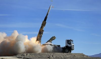"""In this photo provided Monday, Nov. 5, 2018, by the Iranian Army, a Sayyad 2 missile is fired by the Talash air defense system during drills in an undisclosed location in Iran. Iran greeted the reimposition of U.S. sanctions on Monday with air defense drills and a statement from President Hassan Rouhani that the nation faces a """"war situation,"""" raising Mideast tensions as America's maximalist approach to the Islamic Republic takes hold. (Iranian Army via AP)"""
