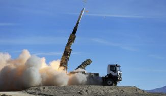 "In this photo provided Monday, Nov. 5, 2018, by the Iranian Army, a Sayyad 2 missile is fired by the Talash air defense system during drills in an undisclosed location in Iran. Iran greeted the reimposition of U.S. sanctions on Monday with air defense drills and a statement from President Hassan Rouhani that the nation faces a ""war situation,"" raising Mideast tensions as America's maximalist approach to the Islamic Republic takes hold. (Iranian Army via AP)"