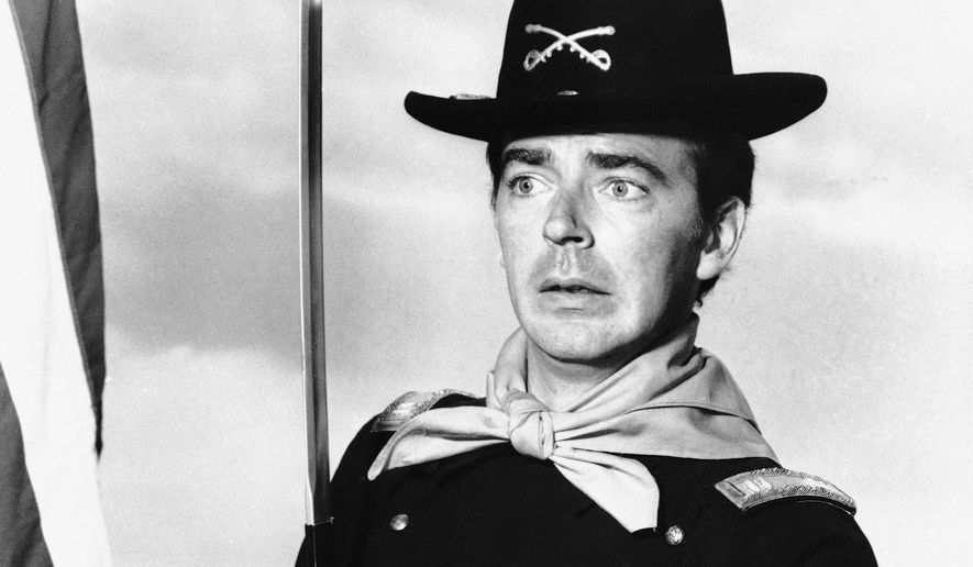 """Ken Berry, who plays Captain Wilton Parmenter in an upcoming TV series called """"F Troop,"""" reaches down the wrong end of cannon in one of the show's episodes, July 1, 1965. Parmenter was promoted from private to captain for leading an unplanned charge in the wrong direction toward the enemy. The new series deals with a strange and comical cavalry troop on the American frontier. (AP Photo)"""