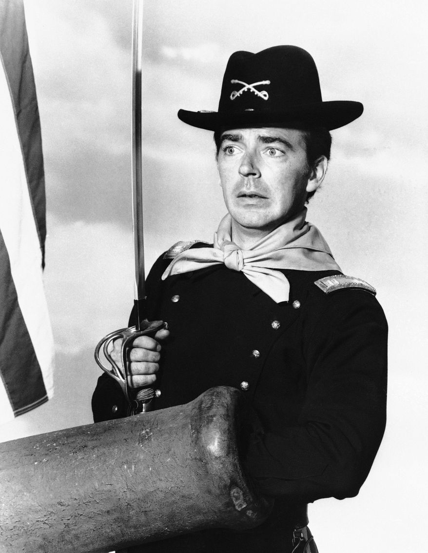 "Ken Berry, who plays Captain Wilton Parmenter in an upcoming TV series called ""F Troop,"" reaches down the wrong end of cannon in one of the show's episodes, July 1, 1965. Parmenter was promoted from private to captain for leading an unplanned charge in the wrong direction toward the enemy. The new series deals with a strange and comical cavalry troop on the American frontier. (AP Photo)"
