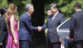 Argentina's President Mauricio Macri and first lady Juliana Awada welcome China's President Xi Jinping at presidential residence in Olivos, a northern suburb of Buenos Aires, Argentina, Sunday, Dec. 2, 2018. (AP Photo/Martin Mejia)