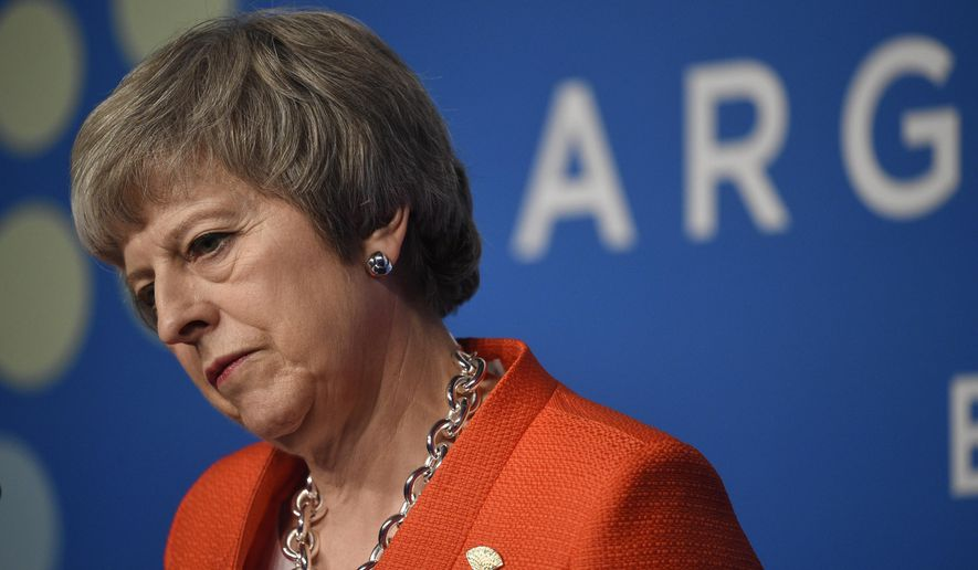 Britain's Prime Minister Theresa May listens to a question during a press conference after the G20 Leader's Summit in Buenos Aires, Argentina, Saturday, Dec. 1, 2018. Leaders from the Group of 20 industrialized nations met for two days in Buenos Aires. (AP Photo/Gustavo Garello)