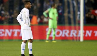 United States' Tyler Adams walks on the pitch at the end of the international friendly soccer match between Italy and the United States, at the Cristal Arena in Genk, Belgium, Tuesday, Nov. 20, 2018. Italy won 1-0. (AP Photo/Francisco Seco)