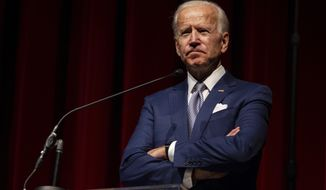 Keynote speaker former Vice President Joe Biden pauses during his speech during the UNLV William S. Boyd School of Law 20th Anniversary Gala at the Bellagio Casino in Las Vegas, Saturday, Dec. 1, 2018. The annual event serves as the school's principal scholarship fundraiser. (Yasmina Chavez/Las Vegas Sun via AP)