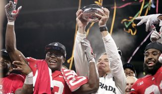 Ohio State head coach Urban Meyer and wide receiver Terry McLaurin, left, celebrate early Sunday, Dec. 2, 2018, after defeating Northwestern 45-24 in the Big Ten championship NCAA college football game in Indianapolis. (AP Photo/Michael Conroy)