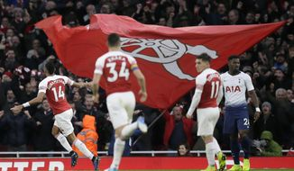 Arsenal's Pierre-Emerick Aubameyang, left, celebrates after scoring his side's second goal during the English Premier League soccer match between Arsenal and Tottenham Hotspur at the Emirates Stadium in London, Sunday Dec. 2, 2018. (AP Photo/Tim Ireland)