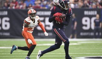 Houston Texans wide receiver DeAndre Hopkins (10) makes a catch in front of Cleveland Browns strong safety Damarious Randall (23) during the first half of an NFL football game, Sunday, Dec. 2, 2018, in Houston. (AP Photo/Eric Christian Smith)
