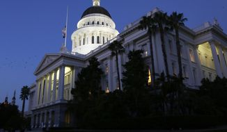 In this Aug. 31, 2018 file photo, the lights of the Capitol dome shine as lawmakers work into the night on the last day of the 2017-2018 Legislative session, in Sacramento, Calif.  (AP Photo/Rich Pedroncelli, File) **FILE**