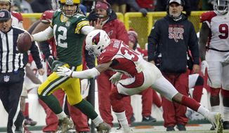 Green Bay Packers quarterback Aaron Rodgers (12) rushes towards the sideline during the last seconds of the second half of an NFL football game against the Arizona Cardinals, Sunday, Dec. 2, 2018, in Green Bay, Wis. (AP Photo/Mike Roemer)