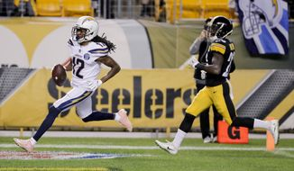 Los Angeles Chargers wide receiver Travis Benjamin (12) dashes past Pittsburgh Steelers cornerback Mike Hilton (28) on his way to a touchdown after making a catch in the first half of an NFL football game, Sunday, Dec. 2, 2018, in Pittsburgh. (AP Photo/Gene J. Puskar)