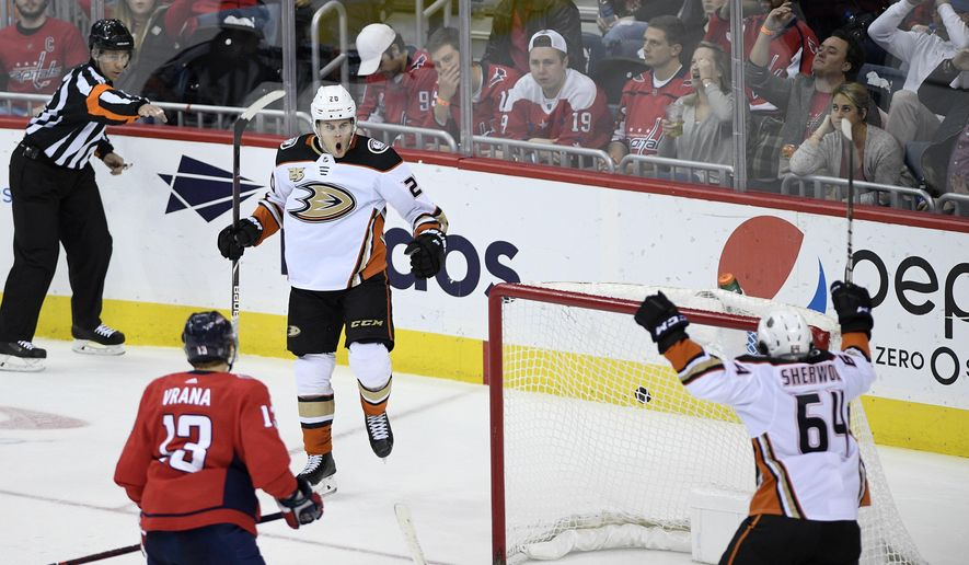 Anaheim Ducks left wing Pontus Aberg (20),, of Sweden, celebrates his goal with Anaheim Ducks right wing Kiefer Sherwood (64) during third period of an NHL hockey game as Washington Capitals left wing Jakub Vrana (13), of the Czech Republic, skates by Sunday, Dec. 2, 2018, in Washington. This was the to be the game-winning goal and his second of the game. The Ducks won 6-5. (AP Photo/Nick Wass)