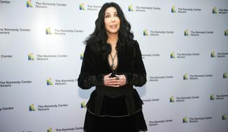 2018 Kennedy Center Honoree Cher arrives at the State Department for the Kennedy Center Honors State Department Dinner on Saturday, Dec. 1, 2018, in Washington. (AP Photo/Kevin Wolf)