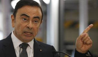 FILE - This Thursday, Nov.8, 2018 file photo, Renault CEO Carlos Ghosn speaks during a visit of French President Emmanuel Macron inside the French carmaker Renault factory of Maubeuge, northern France. Ghosn may have fallen from grace as one of the auto industry's most powerful leaders but Ghosn can count on continued support in at least one corner of the globe. Lebanese have long held hopes that Ghosn, who was born to Lebanese grandparents and holds Lebanese citizenship, would play a bigger role in politics one day or help salvage its increasingly struggling economy. (AP Photo/Francois Mori, File)