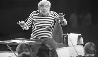 """FILE - In this Oct. 15, 1976, file photo, U.S. conductor Leonard Bernstein conducts musicians of Munich's Bavarian Broadcasting Symphony Orchestra during rehearsal for a concert to be performed for the benefit of Amnesty International on Oct. 17. With 2018 marking the 100th anniversary of Leonard Bernstein's birth, a spotlight has again been placed on the composer's fierce commitment to education, demonstrated throughout his life by activities like the Young People's Concerts and his Harvard Lecture Series. It was during the latter that Bernstein emphasized the importance of """"inter-disciplinary values,"""" explaining that """"the best way to 'know' a thing is in the context of another discipline."""" (AP Photo/Dieter Endlicher, File)"""
