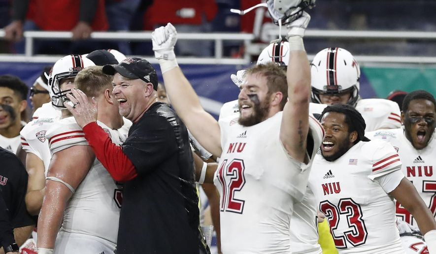 Northern Illinois head coach Rod Carey celebrates during the closing seconds of the Mid-American Conference championship NCAA college football game against Buffalo, Friday, Nov. 30, 2018, in Detroit. (AP Photo/Carlos Osorio)