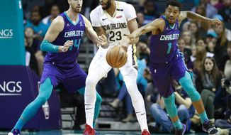 Charlotte Hornets guard Malik Monk, right, steals the ball away from New Orleans Pelicans center Anthony Davis as Hornets forward Frank Kaminsky, left, watches in the first half of an NBA basketball game Sunday, Dec. 2, 2018 in Charlotte, N.C. (AP Photo/Jason E. Miczek)