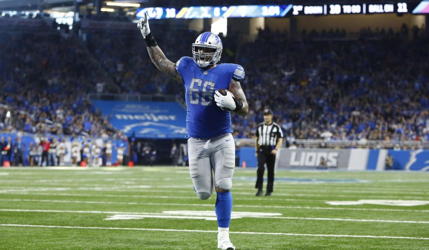 Detroit Lions offensive tackle Taylor Decker runs into the end zone for an 11-yard touchdown during the second half of an NFL football game against the Los Angeles Rams, Sunday, Dec. 2, 2018, in Detroit. (AP Photo/Duane Burleson)