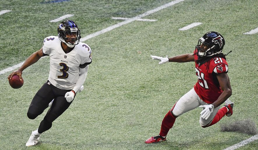 Baltimore Ravens quarterback Robert Griffin III (3) runs out of the pocket against Atlanta Falcons cornerback Desmond Trufant (21) during the second half of an NFL football game, Sunday, Dec. 2, 2018, in Atlanta. (AP Photo/Danny Karnik) ** FILE **
