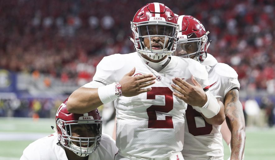 Alabama quarterback Jalen Hurts (2) celebrates after scoring the during the fourth quarter against Georgia during an NCAA college football game for the Southeastern Conference championship Saturday, Dec. 1, 2018, in Atlanta. (AJ ReynoldsAthens Banner-Herald via AP) ** FILE **