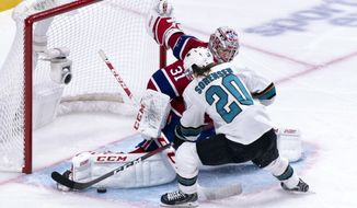 Montreal Canadiens goaltender Carey Price makes a save off San Jose Sharks' Marcus Sorensen during the second period of an NHL hockey game, Sunday, Dec. 2, 2018, in Montreal. (Paul Chiasson/The Canadian Press via AP)