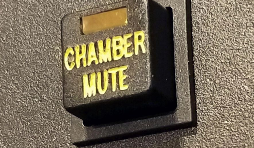 This Feb. 16, 2017, photo provided by Mike Freiberg shows a mute button inside the House of Representatives at the state Capitol in St. Paul, Minn. When Minnesota Democrats take control of their state House in January 2019, one early order of business will be disconnecting a button that allowed majority Republicans to mute their microphones. The parties have skirmished over the capability since the GOP installed it in 2015, with Democrats saying it was being used to silence them and Republicans maintaining it was necessary to keep order. (Mike Freiberg via AP)