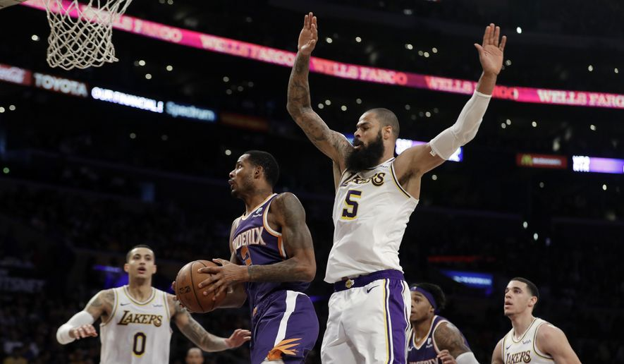 Phoenix Suns' Trevor Ariza, second from left, drives past Los Angeles Lakers' Tyson Chandler (5) during the first half of an NBA basketball game Sunday, Dec. 2, 2018, in Los Angeles. (AP Photo/Marcio Jose Sanchez) **FILE**