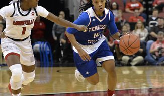 Tennessee State guard Lauren Elliott (10) attempts to drive past the defense of Louisville guard Dana Evans (1) during the first half of an NCAA college basketball game, in Louisville, Ky., Sunday, Dec. 2, 2018. (AP Photo/Timothy D. Easley)