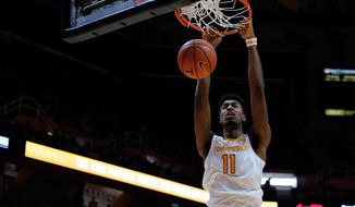 Tennessee forward Kyle Alexander dunks the ball in the first half of an NCAA college basketball game against Texas A&M Corpus Christ,i Sunday, Dec. 2, 2018, in Knoxville, Tenn. (AP Photo/Shawn Millsaps)