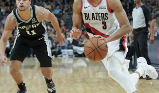 Portland Trail Blazers' C.J. McCollum (3) drives around San Antonio Spurs' Bryn Forbes during the second half of an NBA basketball game, Sunday, Dec. 2, 2018, in San Antonio. San Antonio won 131-118. (AP Photo/Darren Abate)