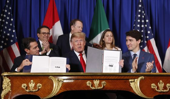 President Donald Trump, Canada's Prime Minister Justin Trudeau, right, and Mexico's President Enrique Pena Nieto, left, participate in the USMCA signing ceremony, Friday, Nov. 30, 2018 in Buenos Aires, Argentina. (AP Photo/Pablo Martinez Monsivais)