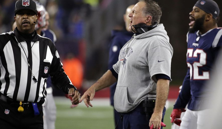 New England Patriots head coach Bill Belichick, center, appeals to side judge Adrian Hill, left, during the second half of an NFL football game against the Minnesota Vikings, Sunday, Dec. 2, 2018, in Foxborough, Mass. (AP Photo/Elise Amendola)
