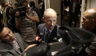 Attorney Michael Avenatti is interviewed by reporters after California Republican gubernatorial candidate John Cox and Democratic candidate Gavin Newsom both spoke at the Willie L. Brown Breakfast Club in San Francisco, Tuesday, Oct. 30, 2018. (AP Photo/Jeff Chiu)