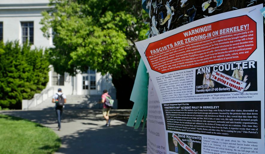 In this April 21, 2017, file photo, a leaflet is seen stapled to a message board near Sproul Hall on the University of California at Berkeley in Berkeley, Calif. (AP Photo/Ben Margot, File)